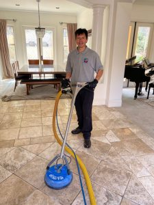 tito cleaning tile and grout